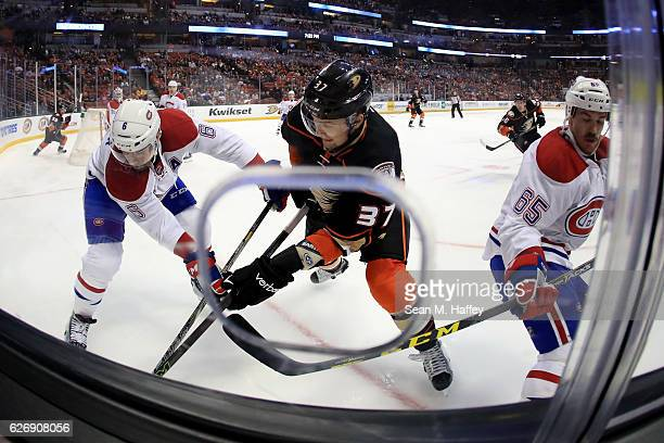 Shea Weber and Andrew Shaw of the Montreal Canadiens defend against Nick Ritchie of the Anaheim Ducks during the second period of a game at Honda...