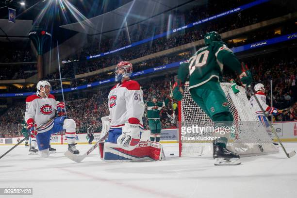 Shea Weber and Carey Price of the Montreal Canadiens react after Ryan Suter of the Minnesota Wild scores a goal during the game at the Xcel Energy...