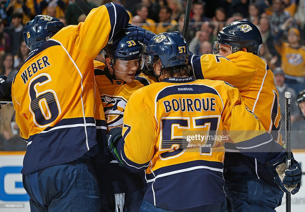 Shea Weber #6 and Gabriel Bourque #57 celebrate the goal of Colin Wilson #33 of the Nashville Predators against the Edmonton Oilers during an NHL game at the Bridgestone Arena on March 8, 2013 in Nashville, Tennessee.