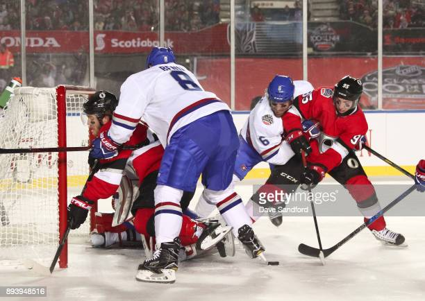Shea Weber and Jordie Benn of the Montreal Canadiens battle with Matt Duchene and Mike Hoffman of the Ottawa Senators during the 2017 Scotiabank...