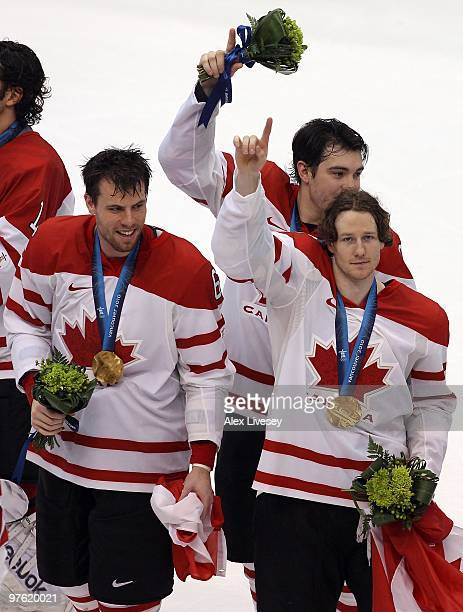 Shea Weber, Drew Doughty and Duncan Keith of Canada celebrate after the ice hockey men's gold medal game between USA and Canada on day 17 of the...