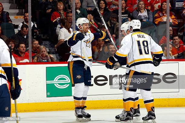 Shea Weber James Neal and teammates of the Nashville Predators celebrate a goal against the Calgary Flames during an NHL game at Scotiabank...