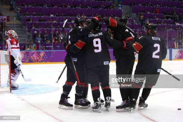 Shea Weber of Canada celebrates with his teammates after scoring a goal in the first period againt Bernhard Starkbaum of Austria during the Men's Ice...