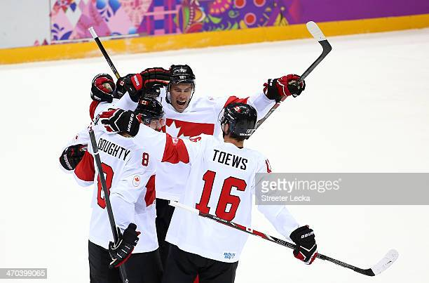 Shea Weber of Canada celebrates with teammates Drew Doughty Ryan Getzlaf and Jonathan Toews after scoring a third period goal against Latvia during...