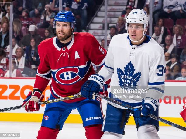 Shea Weber of the Montreal Canadiens and Auston Matthews of the Toronto Maple Leafs look towards the action during the NHL game at the Bell Centre on...