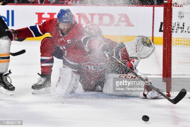Shea Weber of the Montreal Canadiens and goaltender Carey Price get sprayed with ice as they defend the net against the Boston Bruins during the...