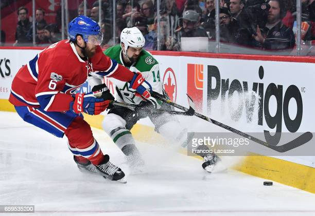 Shea Weber of the Montreal Canadiens and Jamie Benn of the Dallas Stars fight for the puck in the NHL game at the Bell Centre on March 28 2017 in...