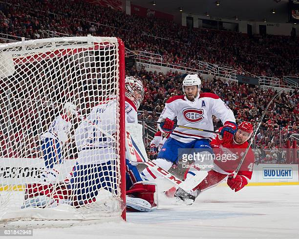 Shea Weber of the Montreal Canadiens battles for position with Luke Glendening of the Detroit Red Wings in front of goaltender Carey Price of the...