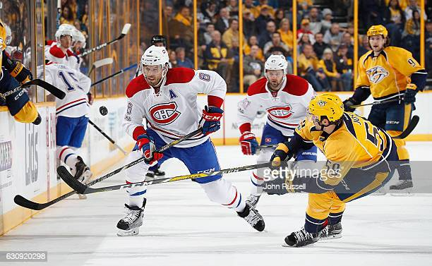 Shea Weber of the Montreal Canadiens battles for the puck against Roman Josi of the Nashville Predators during an NHL game at Bridgestone Arena on...