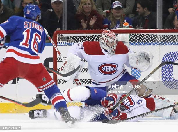 Shea Weber of the Montreal Canadiens blocks the puck during the first period against Ryan Strome of the New York Rangers at Madison Square Garden on...