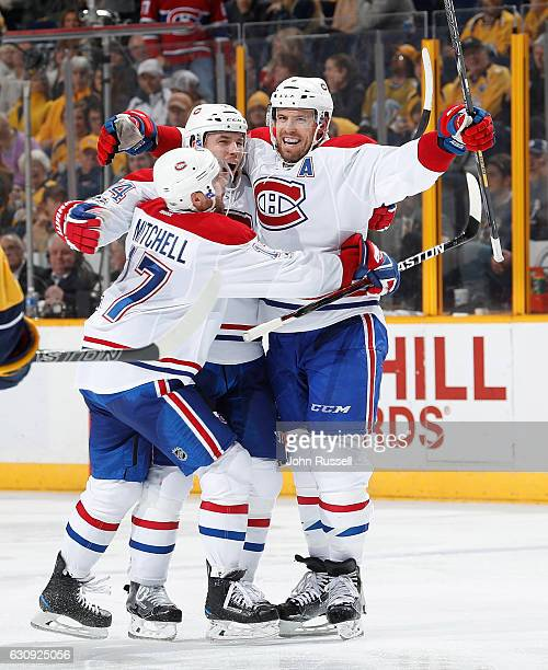 Shea Weber of the Montreal Canadiens celebrates his goal with Tomas Plekanec and Torrey Mitchell against the Nashville Predators during an NHL game...