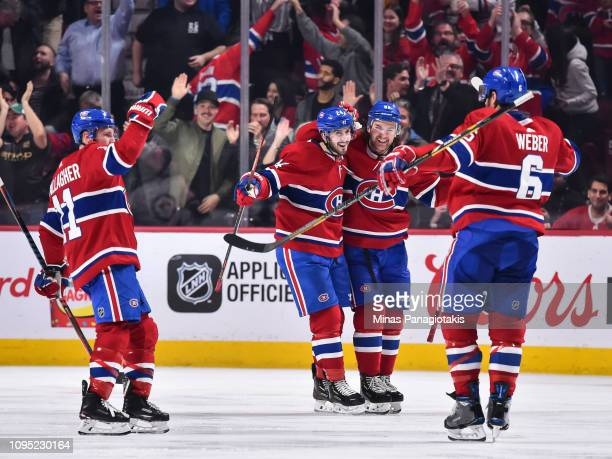 Shea Weber of the Montreal Canadiens celebrates his third period goal with teammates Brendan Gallagher, Phillip Danault and Jonathan Drouin against...