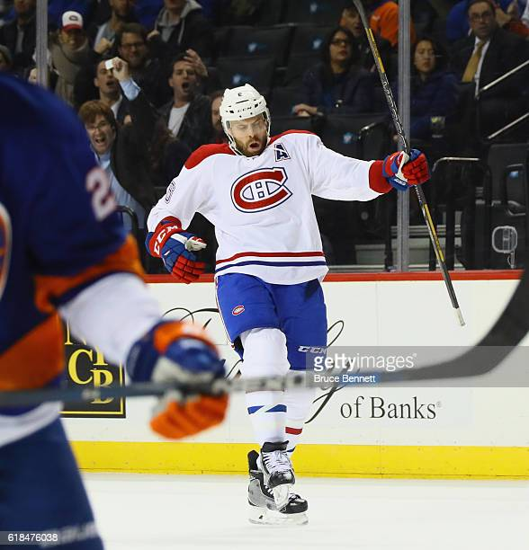 Shea Weber of the Montreal Canadiens celebrates the game winning powerplay goal at 17:03 of the third period against the New York Islanders at the...
