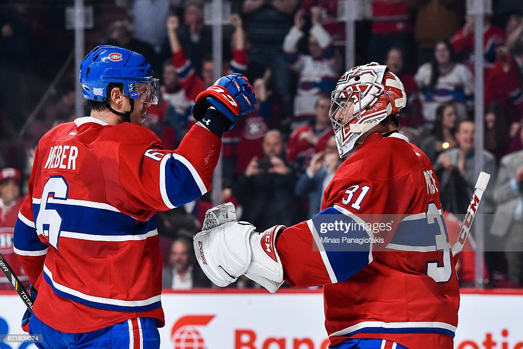 Shea Weber #6 of the Montreal Canadiens congratulates Carey Price #31 for their victory over the Boston Bruins during the NHL game at the Bell Centre on November 8, 2016 in Montreal, Quebec, Canada. The Montreal Canadiens defeated the Boston Bruins 3-2.