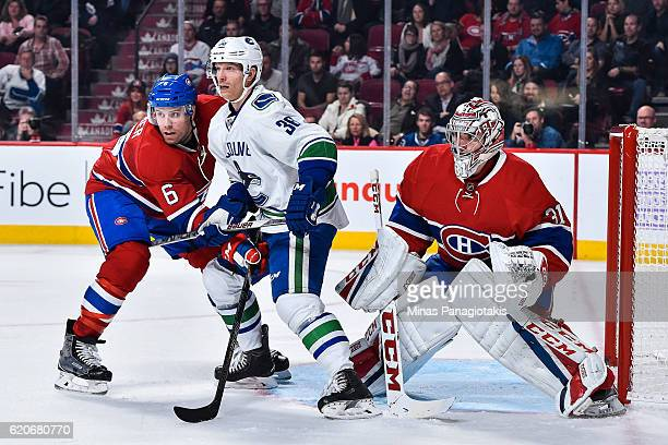 Shea Weber of the Montreal Canadiens defends against Jannik Hansen of the Vancouver Canucks near goaltender Carey Price during the NHL game at the...