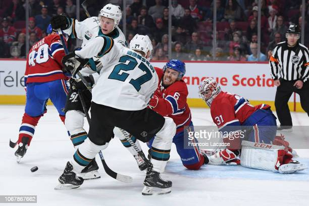 Shea Weber of the Montreal Canadiens defends the goal against Joonas Donskoi and Antti Suomela of the San Jose Sharks in the NHL game at the Bell...