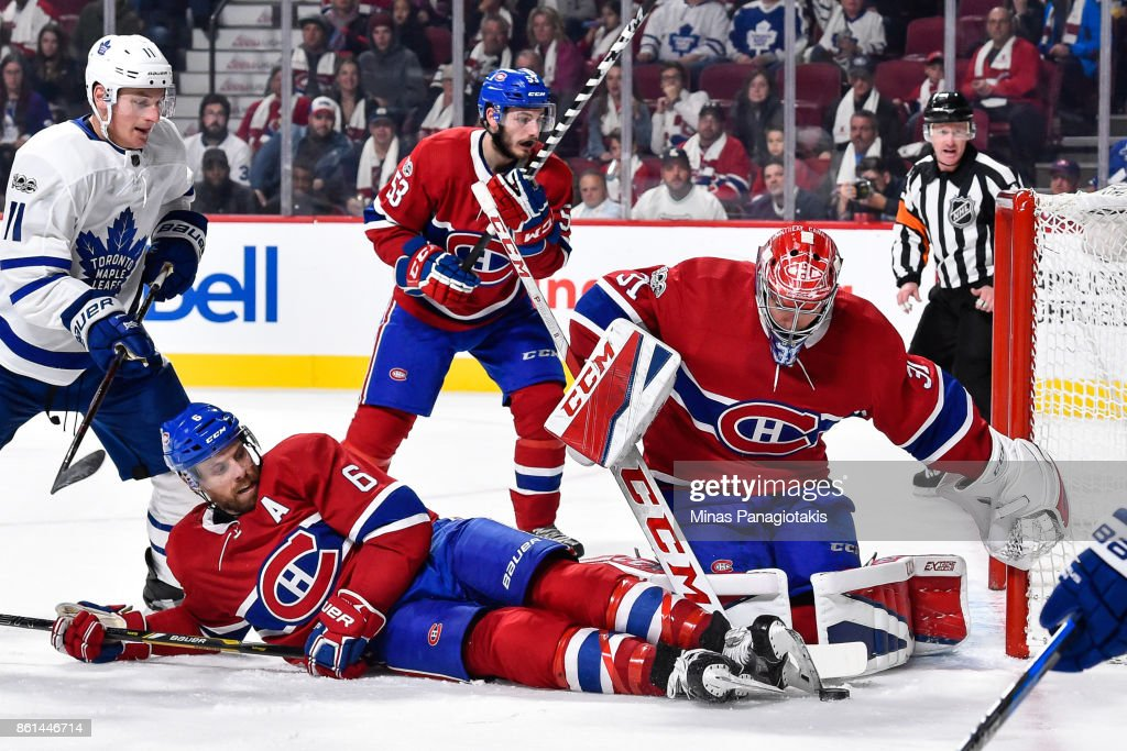 Shea Weber #6 of the Montreal Canadiens falls as he tries to defend the puck near goaltender Carey Price #31 against the Toronto Maple Leafs during the NHL game at the Bell Centre on October 14, 2017 in Montreal, Quebec, Canada. The Toronto Maple Leafs defeated the Montreal Canadiens 4-3 in overtime.