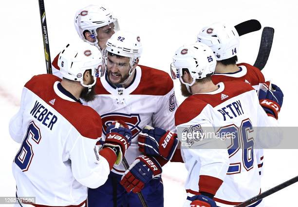 Shea Weber of the Montreal Canadiens is congratulated by teammates Jonathan Drouin Jeff PetryNick Suzuki and Brendan Gallagher of the Montreal...