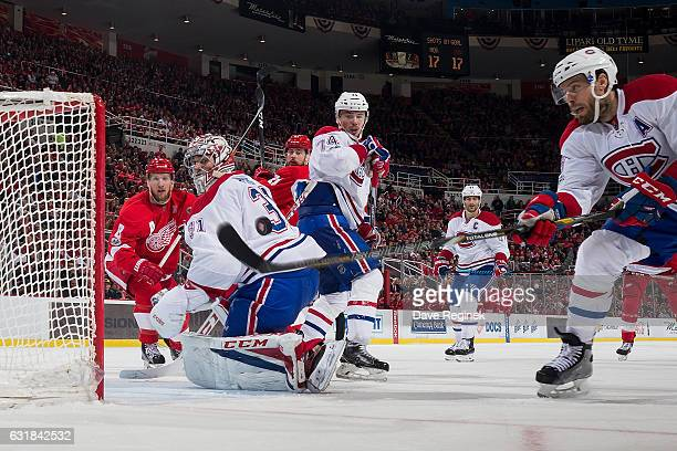 Shea Weber of the Montreal Canadiens reaches for the puck in front of teammate goaltender Carey Price as Alexei Emelin of the Canadiens and Justin...