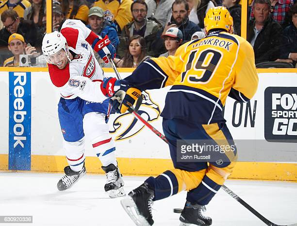 Shea Weber of the Montreal Canadiens shoots the puck against Calle Jarnkrok of the Nashville Predators during an NHL game at Bridgestone Arena on...