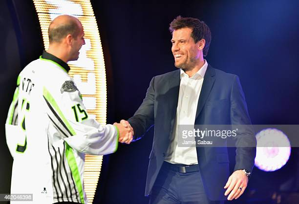 Shea Weber of the Nashville Predators and Team Toews greets Ryan Getzlaf of the Anaheim Ducks onstage during the NHL AllStar Fantasy Draft as part of...