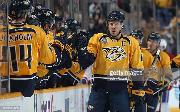 Shea Weber of the Nashville Predators celebrates his goal along the bench against the Montreal Canadiens during an NHL game at Bridgestone Arena on...