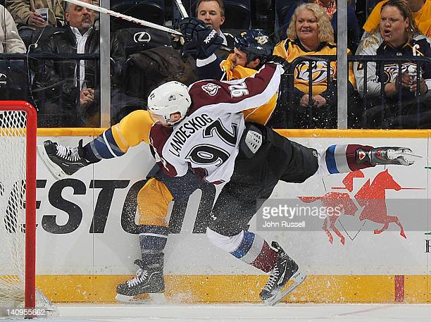 Shea Weber of the Nashville Predators checks Gabriel Landeskog of the Colorado Avalanche during an NHL game at the Bridgestone Arena on March 8 2012...