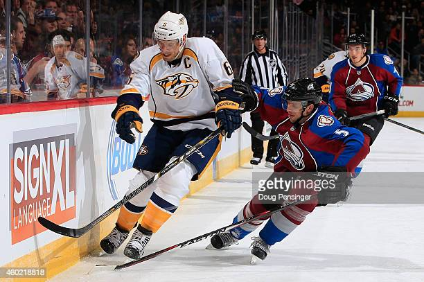 Shea Weber of the Nashville Predators controls the puck against Nate Guenin of the Colorado Avalanche at Pepsi Center on December 9 2014 in Denver...