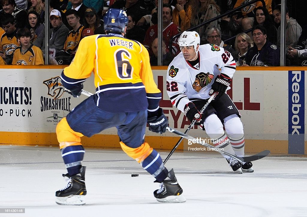 Shea Weber #6 of the Nashville Predators defends Jamal Mayers #22 of the Chicago Blackhawks at the Bridgestone Arena on February 10, 2013 in Nashville, Tennessee.