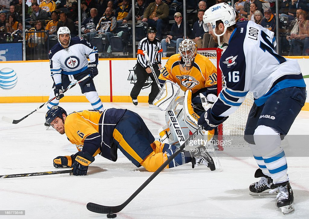 Shea Weber #6 of the Nashville Predators eyes the puck against Andrew Ladd #16 of the Winnipeg Jets at Bridgestone Arena on October 24, 2013 in Nashville, Tennessee.