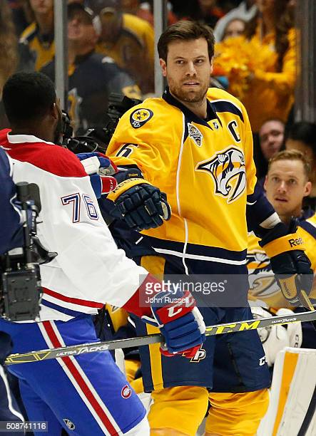 Shea Weber of the Nashville Predators fist bumps PK Subban of the Montreal Canadiens after competing in the AMP Energy NHL Hardest Shot during 2016...