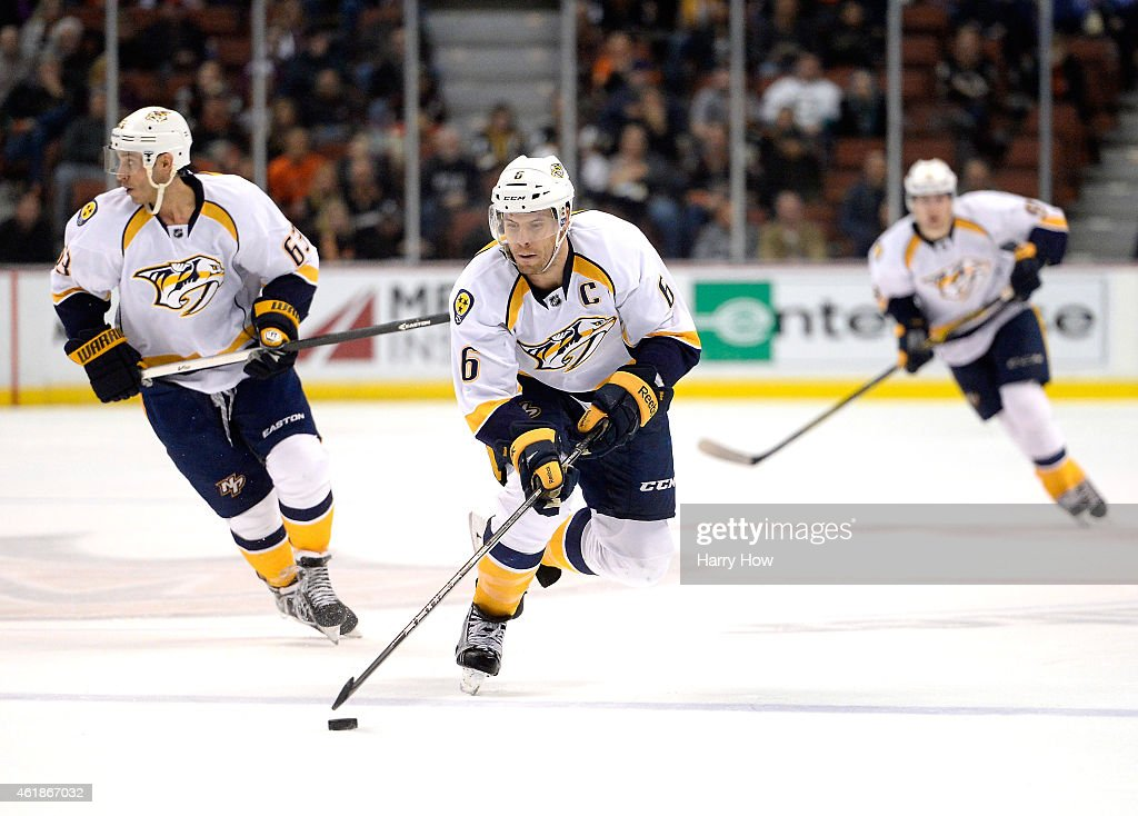 Shea Weber #6 of the Nashville Predators ruses the puck in front of Mike Ribeiro #63 against the Anaheim Ducks during the third period at Honda Center on January 4, 2015 in Anaheim, California.