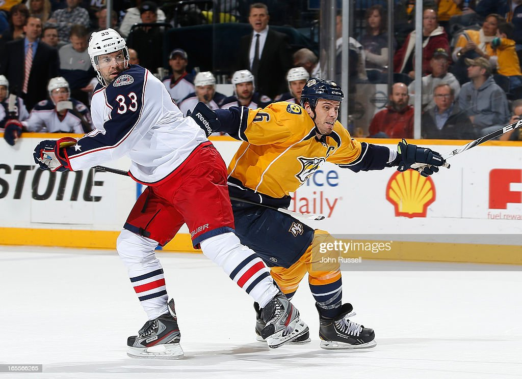 Shea Weber #6 of the Nashville Predators skates against Adrian Aucoin #33 of the Columbus Blue Jackets during an NHL game at the Bridgestone Arena on April 4, 2013 in Nashville, Tennessee.