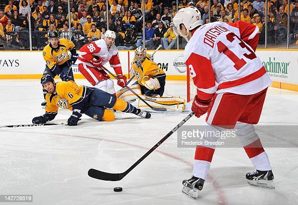 Shea Weber of the Nashville Predators slides to block a shooting lane in front of Pavel Datsyuk of the Detroit Red Wings in Game One of the Western...