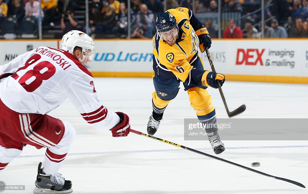 Shea Weber #6 of the Nashville Predators takes a slapshot against the Arizona Coyotes at Bridgestone Arena on October 21, 2014 in Nashville, Tennessee.