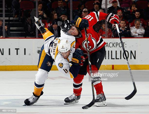 Shea Weber of the Nashville Predators takes a two minute penalty for holding Steve Bernier of the New Jersey Devils during the third period at the...