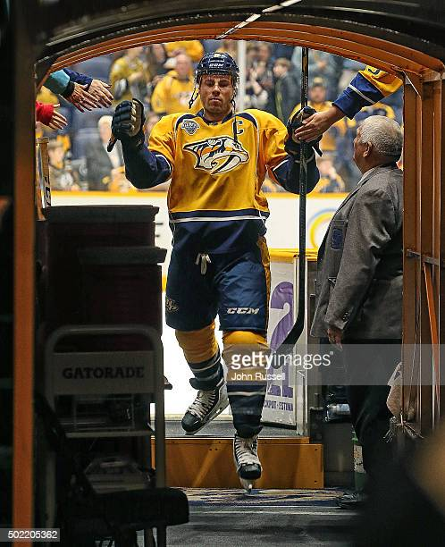 Shea Weber of the Nashville Predators taps hands with fans after warmups prior to an NHL game against the Montreal Canadiens at Bridgestone Arena on...