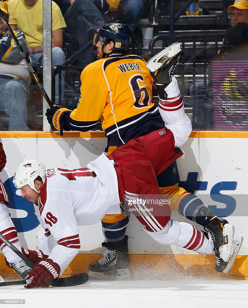 Shea Weber #6 of the Nashville Predators upends David Moss #18 of the Phoenix Coyotes during an NHL game at Bridgestone Arena on April 10, 2014 in Nashville, Tennessee.