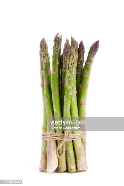 sheaf of fresh asparagus isolated on white background - asparagus stock pictures, royalty-free photos & images