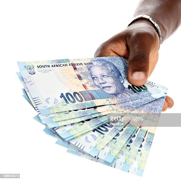 sheaf of new mandela hundred rand banknotes in male hand - south african currency stock photos and pictures