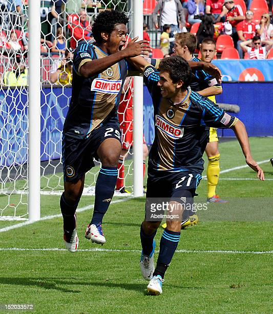 Sheanon Williams and Michael Farfan of the Philadelphia Union celebrate a goal against Toronto FC during MLS action at the BMO Field September 15...