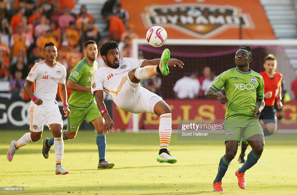 Sheanon Williams #22 of the Houston Dynamo kicks the ball in front of Obafemi Martins #9 of the Seattle Sounders FC in the second half of their game at BBVA Compass Stadium on October 18, 2015 in Houston, Texas.