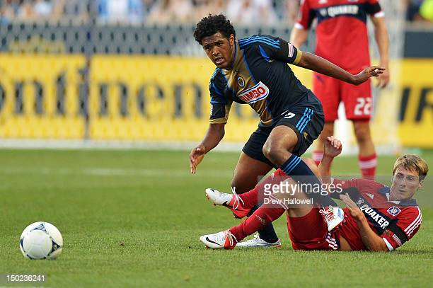 Sheanon Williams of the Philadelphia Union climbs over Chris Rolfe of the Chicago Fire to get to the ball at PPL Park on August 12 2012 in Chester...