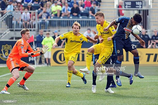 Sheanon Williams of the Philadelphia Union stops the ball with his face in front of teammate Zac MacMath Chad Marshall and Olman Vargas of the...