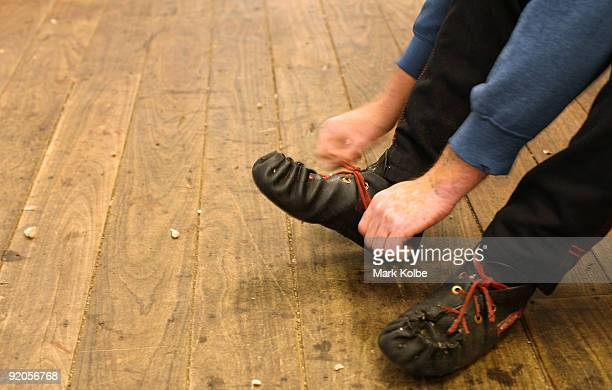 A shearer puts on his moccasins on at the start of a day of spring shearing at Cherry Hill Pastoral Company property on October 19 2009 in Uralla...