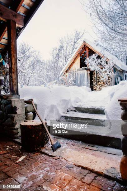 Shed and snowy steps near rural house