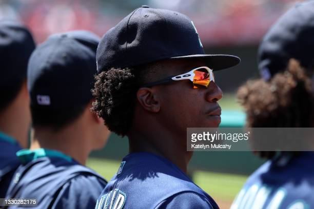 Shed Long Jr. #4 of the Seattle Mariners looks on from the dugout during the fifth inning against the Los Angeles Angels at Angel Stadium of Anaheim...