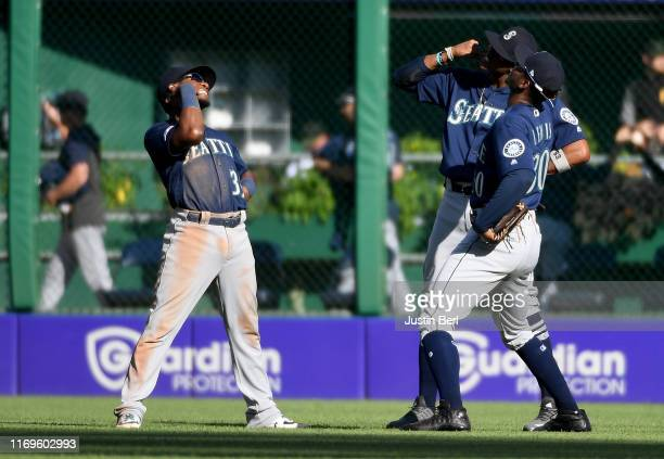 Shed Long of the Seattle Mariners celebrates with Keon Broxton and Kyle Lewis after the final out in a 65 win over the Pittsburgh Pirates at PNC Park...