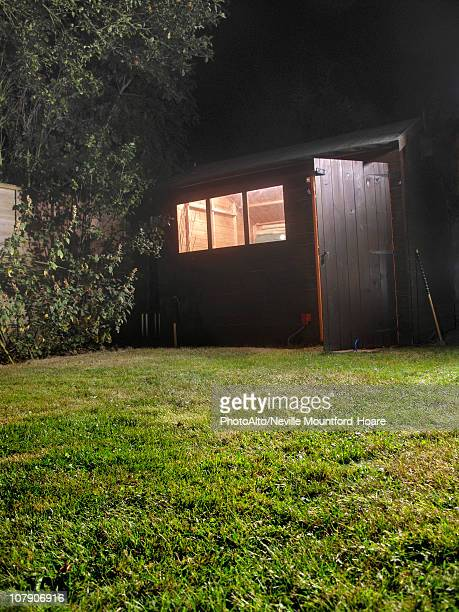 shed with open door at night - shed stock pictures, royalty-free photos & images