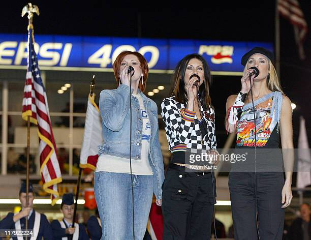 SHeDAISY sings the National Anthem before the start of The Budweiser Shootout at Daytona